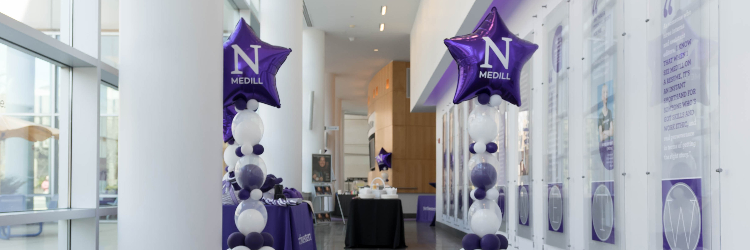 Entrance to the McCormick Foundation Center building; purple and white balloons are on the sides and a purple carpet is on the ground