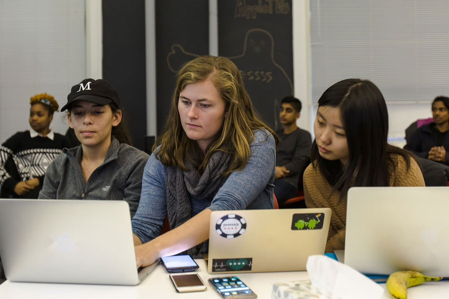 Students in the Knight Lab work on a project on a computer