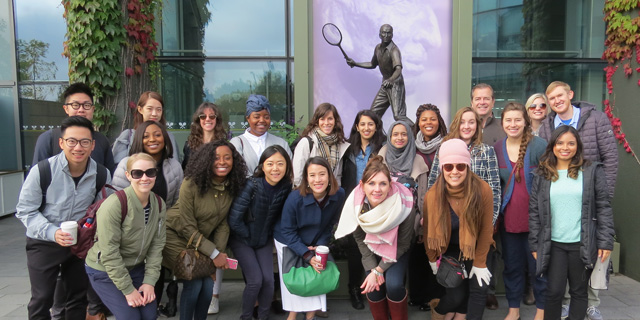 Large group of students posing for photo in front of The All England Lawn Tennis Club