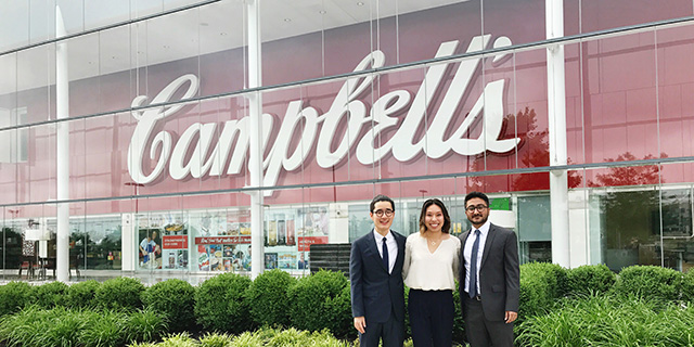 Students in front of Campbell's Soup sign