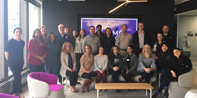 IMC students pose for a photo at Medill's Chicago campus