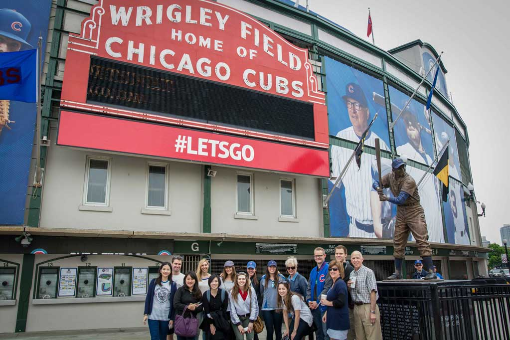 Student pose in front of Wrigley field during a special tour.