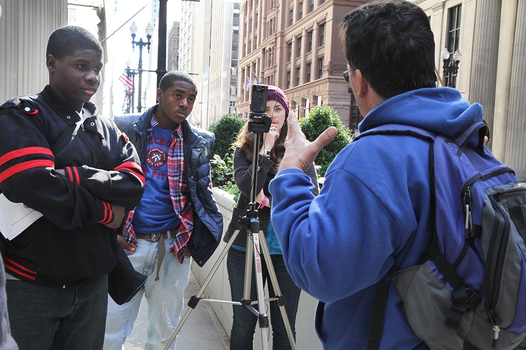 Teen participants and mentors conduct an interview