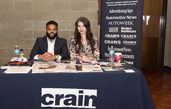 Career fair with a table for Crain.