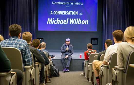 Wilbon speaking to students at Medill in classroom