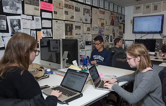 students working at the daily office on campus