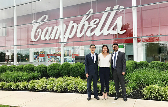 Students in front of a giant Campbell's sign