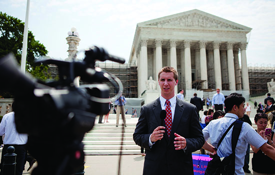 Student reporting on camera in Washington, D.C., in front of the Supreme Court building.