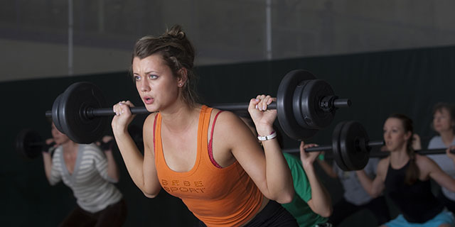 Student lifting large weight in a weight class