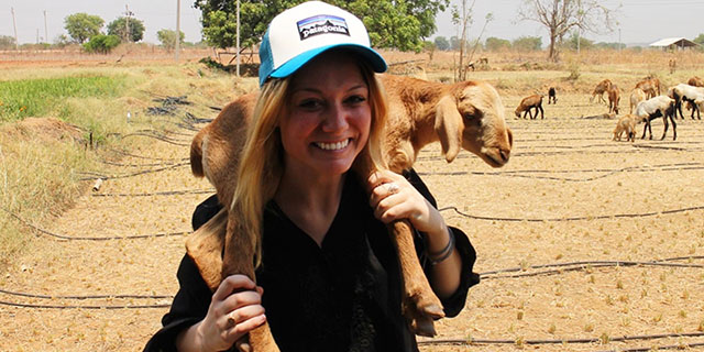 Comer scholar Janice Cantieri with a baby goat around her neck during a reporting trip to India.