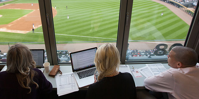 Students cover the Chicago White Sox game from the booth