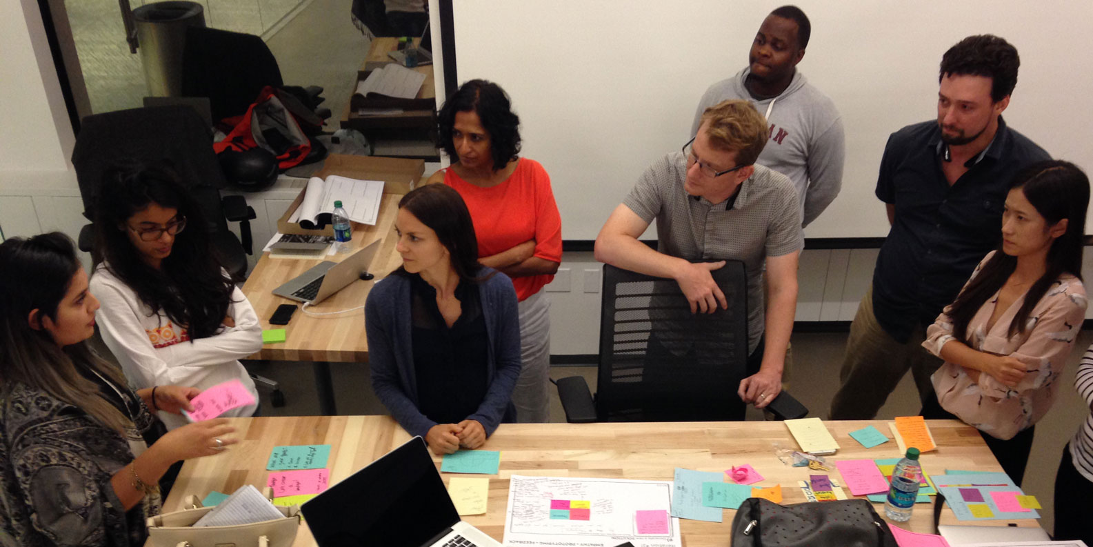 Students work together around a desk at Medill's San Francisco space