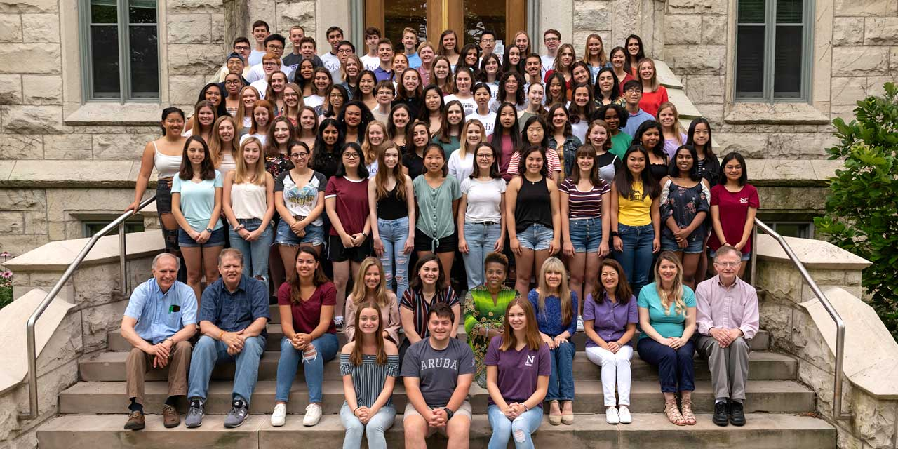 2017 Medill cherubs pose for a photo on the stairs of a building