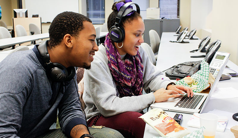 Medill student and teen working on project together