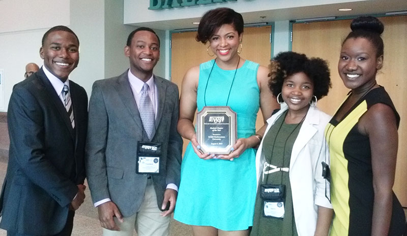 Members of Northwestern's NABJ chapter, display the Student Chapter of the Year award they won at the national NABJ convention.