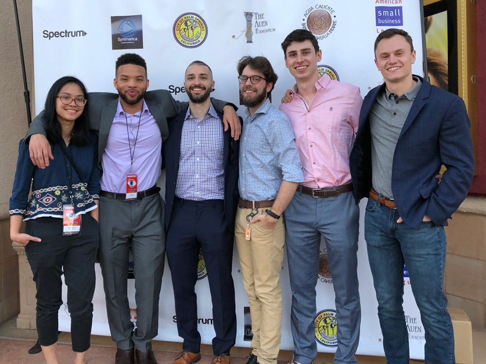 Six Medill students and alumni pose for a photo at the AmDocs Film Festival