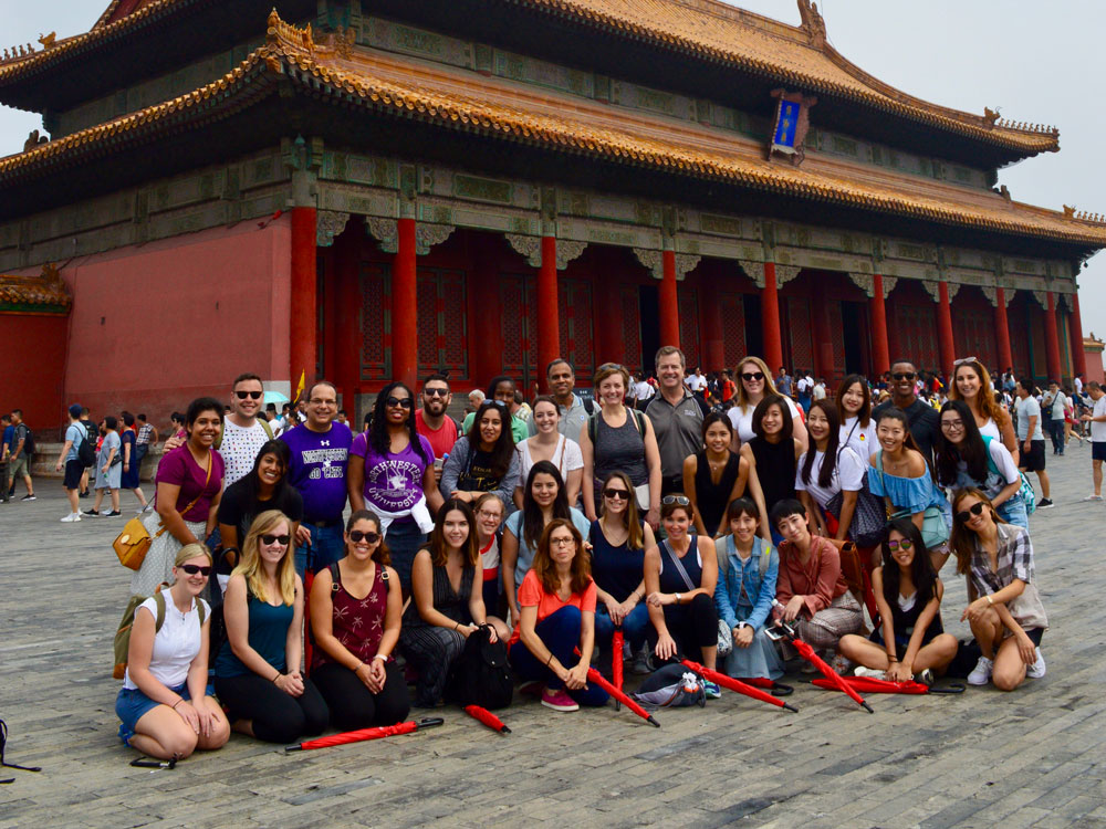 Medill IMC students pose for a photo at the Forbidden City in Beijing