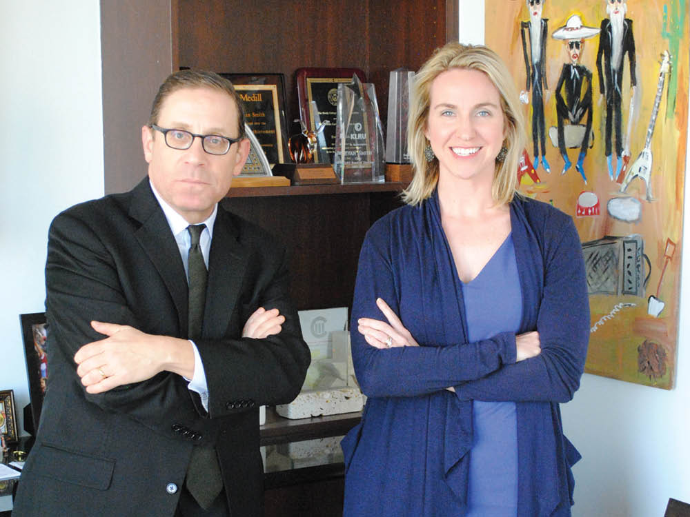 Texas Tribune Co-Founder and CEO Evan Smith and Editor-in-Chief Emily Ramshaw pose for a photo at the Texas Tribune office