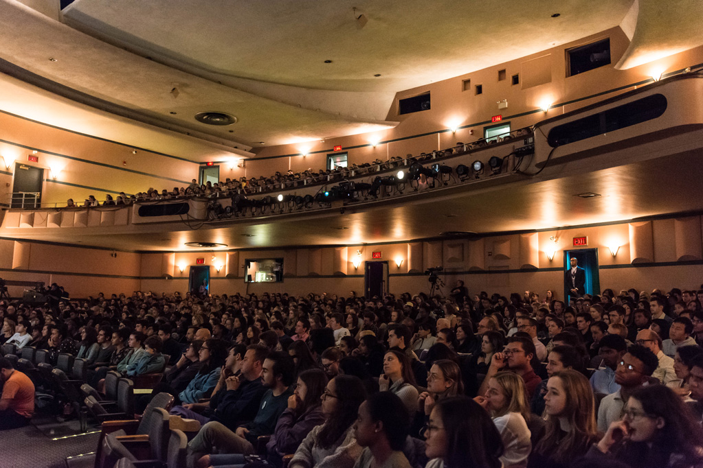 Photo taken of the crowd and full seats filled with students in Cahn Auditorium