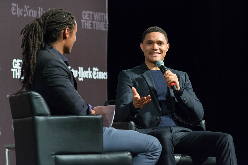 Trevor Noah speaks on stage with Medill alumnus John Eligon