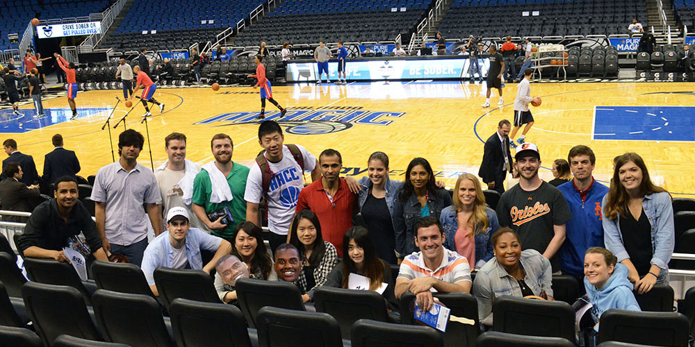 Students get a courtside view before the Orlando Magic game at the Amway Center.