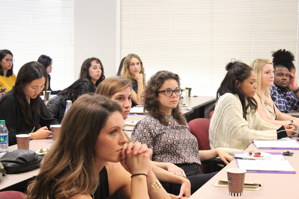 Medill students listen to presentation at health care reporting conference