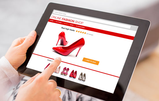 A person shops online for shoes